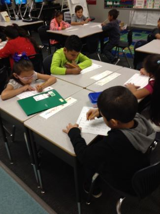 Students in classroom performing math problems