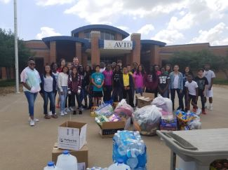 Front of school, students and hurricane donations
