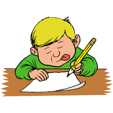 Boy writing at a desk