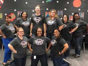 ISLE Teachers standing in front of wall of stars