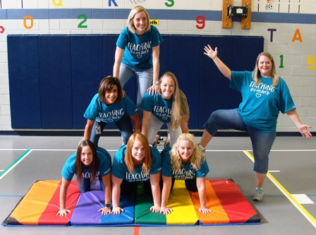 Teachers standing in a pyramid