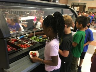Students making selections from salad bar