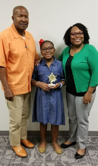 Tierany with her parents
